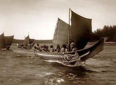 1914 by Edward S. Curtis.  Kwakiutl in canoes, British Columbia.