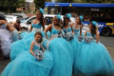 I'm thinking these are PERFECT bridesmaids dresses. They're blue and sparkly... and we can wear feathers in our hair! Love you!