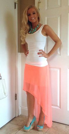 Coral high low skirt like the outfit but the girl is almost the same color as the skirt