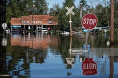 A roadway is flooded by remnants of Hurricane Matthew on October 11, 2016 in Fair Bluff, North Carolina. Thousands of homes have been damaged in North Carolina as a result of the storm and many are still under threat of flooding.