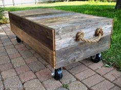 cart style coffee table on wheels... I want to add hinges and a lid for extra storage space!