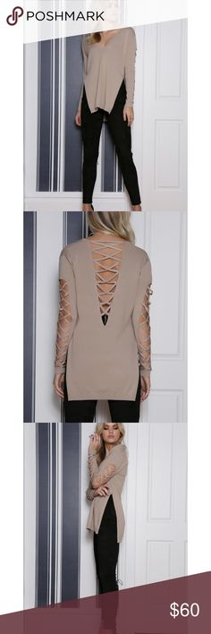 """Taupe Criss Cross Knit Sweater from Runaway Taupe Criss Cross Knit Sweater from Runaway the Label, cult favorite Aussie label. Show a little skin in a chic style with this gorgeous piece! Featuring a deep V cut out at the back with criss cross detailing at the back and down the sleeves. -Criss cross detailing down the sleeves and at the back -High splits on the side Approx. 30"""" long. Armpit to armpit approx. 18""""across laying flat. Side slit 14"""". L 80% rayon, 20% nylon Aussie size 6=US size…"""