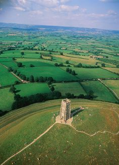 Glastonbury Tor, St Michael's Tower and the beautiful Somerset countryside, UK. This isn't Wells but, it is Somerset. England And Scotland, England Uk, Somerset England, Glastonbury Tor, Glastonbury England, Glastonbury Somerset, London 2012 Opening Ceremony, Places To Travel, Places To See