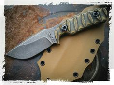 DEBAUD BLADES custom handmade tactical fixed blade made from 5160 spring steel with Camo layered canvas micarta scales.