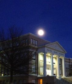 Boise High shines at night in the glow of a full moon.