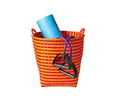 How to Build a Home Gym: Basket Case. Stash tone-up tools in a cheap and cheery bin like this one. #SelfMagazine