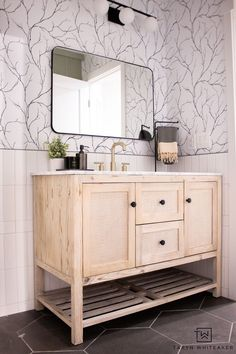 First peek of the Black and White Bathroom Vanity with rattan vanity, hexagon floor and half wall subway tile.