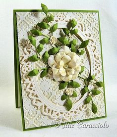 Wow!!  This site is fantastic.  Beautiful cards with good info on how to make them.  Lots of punches and stamps.  Love!!