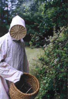 Martin Buckle wears a copy of a 16th-century beekeeper's clothing, inspired by a Breughel painting circa 1560.