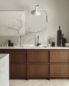 We're going to be seeing lots of non white kitchens! Love the warm wood and mix of materials here. By Nordiska Kok.