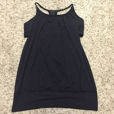 Lululemon black tank w/ dark camo print bra Barely worn lulu lemon loose tank with built in dark camo bra. Very cute. This is long so if your shirt wasted you may not like it unless you like the long length. Smoke and cat free home. Tag was removed due to being bothersome. I'm usually a size 10 but could fit 8 or a small 12 lululemon athletica Other