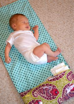 DIY your own wipe-able and washable changing pad, with diaper pockets. (this post is at the bottom of the page)