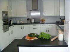 My kitchen is the heart of the home - we cook, eat, play, craft, and even do our homeschooling in here!