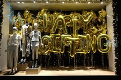 "Christmas windows: J. Crew ""Happy Gifting"" Christmas window display on Regent Street"