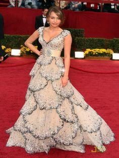Miley Cirus 2009. I'd put a nude lace cami under it...