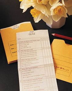 On the tables were pop quizzes about the couple for guests to fill out and deposit in drop boxes covered in paper. The bride and groom mailed the graded quizzes after the wedding with their thank-you notes.
