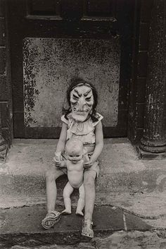 "This Diane Arbus photograph reminds me of Frida Kahlo's "" Little Girl with DeathMask ""."