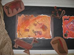 2nd grade cave paintings- watercolor/oil pastel resist