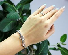 Wired knot nail bangle bracelet Available in 3 colors : gold, silver and black Adjustable