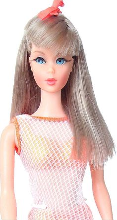 Twist 'n Turn Barbie Doll; had (still have) her in this fishnet swimsuit