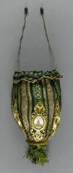 Woman's Bag with Views of Paris    Made in France  Early to mid- 19th century    Artist/maker unknown, French    Silk and metallic thread knit, gilded metal, hand-colored lithographs, silk cord, beading  (Including drawstring): 4 x 3 x 16 inches (10.2 x 7.6 x 40.6 cm)