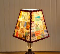 Vintage stamp lamp shade.     This one is from Etsy, but I'm pretty sure I've still got all those old stamps and I think I'll try to put one together!