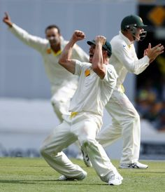 Australia's David Warner (front) celebrates after he took the catch to dismiss England's Matt Prior during the fourth day's play of the first Ashes cricket test match in Brisbane November 24, 2013.