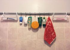 Need more shower storage? Use a tension rod, shower baskets and some curtain hooks to create more shower space. It's simple and space saving.