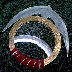Chakram - I created Fallon's bolt-disks by combining a chakram, a shuriken (throwing star), lightning bolts, and a sawblade.
