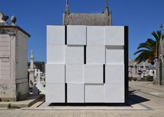 Family mausoleum built from white marble and black glass | Portuguese studio Armazenar Ideias used blocks of white marble to build this cube-shaped mausoleum for a family living in the city of Póvoa de Varzim (+ slideshow).