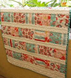 Neat idea to show off larger prints in a quilt!