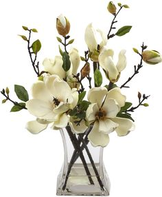 Features: -Delicate magnolia blooms. -Decorative vase included. -Liquid Illusion faux water. Holiday Theme: -Yes. Product Type: -Floral Arrangements. Color: -White. Seasonal Theme: -Yes. Flowe