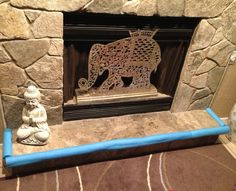 Perfect solution for baby proofing your stone hearth.  Foam pool noodles. This is working great!!!
