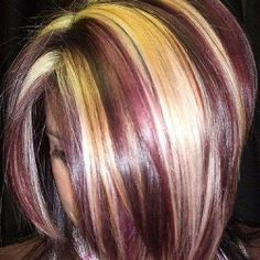 Chunky blonde streaks with burgundy.