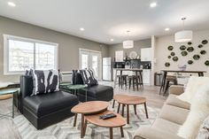 Modern community lounge for apartment building. Area rug, leather, furniture, accessories, accent tables, succulents, artwork, pillows, pattern, comfy, relax