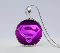 Avengers Super Girl Necklace -Show you are a true Super Girl Fan by wearing this super cool purple-pinky Necklace.  A perfect gift for an Avengers fanatic