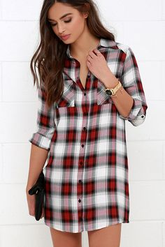 Slip the Jack by BB Dakota Brielle Red Plaid Shirt Dress under your favorite jacket for a cute and casual look that will surely impress! Lightweight woven rayon with a black, red, and ivory plaid print begins at a collared neckline before transitioning into a full-length button placket. Long sleeves with button cuffs can be rolled up and secured with button tabs on either side of a straight-cut bodice, accented with two patch pockets.