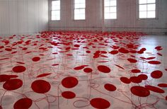 """Beili Liu"""" Red Thread Legend Series """" is a set of premises of the artist, inspired by an ancient Chinese legend that says that when children are born red wires are connected by invisible people who are destined to be during their lives. The installation consists of thousands of records of red wires coiled spiral that swing and turn suspended by wires to the ground"""