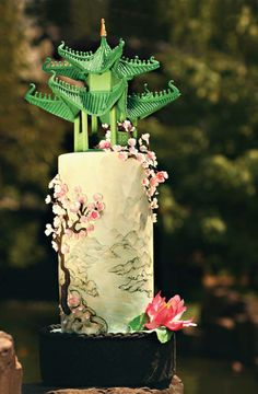 Inspired by antique Chinese silk paintings, This hand-painted cake features a 3-D sugarpaste cherry blossom tree relief and is topped with a lime green sugarpaste pagoda.Cate Scaglione Photography <3
