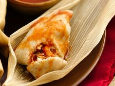 Chicken Tamales with Adobo Sauce; The authentic flavor in these tamales comes from the corn masa in the dough and the corn husks they are steamed in. The chipotle chiles in adobo sauce give the chicken filling a slightly smoky taste.