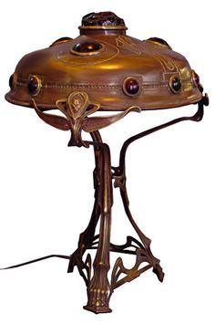 Via goantiques.com Steamer style/EXTREMELY rare and unusual antique Art Nouveau $12,500.00 lamp with multi-colored chunk jewels. Made of bronze, this is a spectacular table lamp.