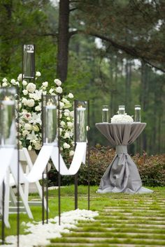 stylish lanterns in aisle and elegant display of tablecloth
