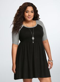 <p>A sporty style with a little spice. We know how much you love our skater dresses, so we made you a super-cool black style with grey raglan…