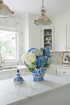 A classic white kitchen with touches of blue and white porcelain and China will always be my personal favourite. Trends come and go but classic style is forever timeless. Classic White Kitchen, Timeless Kitchen, Blogger Home, Blue Hydrangea, Hydrangeas, Blue And White China, Ginger Jars, White Decor, Beautiful Kitchens