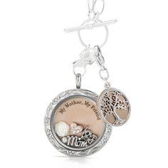 Time and life change quickly, but your mom never will. Capture your love for your mother and tell her she's always in your thoughts with this special Origami Owl Living Locket look. This set comes with Living Locket, Plate, Dangle, Chain and Charms.
