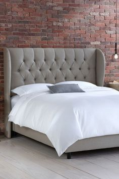 Grey Tufted Wingback Bed
