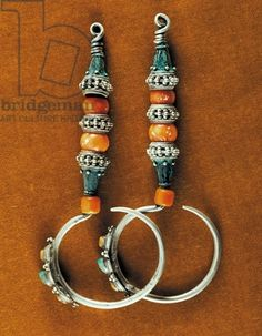 Region of Tibet | Earrings in sterling silver, coral and turquoise | ca. early 20th century