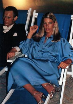 Helmut Newton - this look feminine in rock was so in mode during the late seventies, blousy satin/silk dress with strappy heels. I'm betting this must be from Dior.