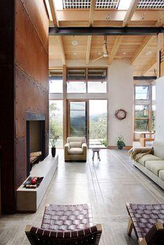 Low maintenance concrete floors, rusted iron fireplace, + Douglas fir ceilings.