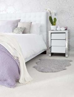 Glamourous white and silver colour scheme. Like everything except the lilac.